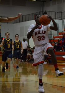 Kenari Moore (32) drives for a dunk in Milan's win over Airport. (Photo by Paula Dotson)