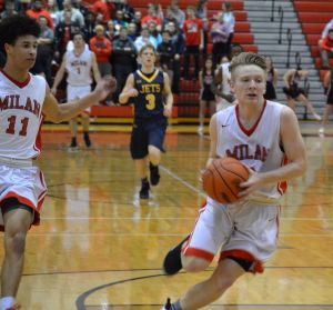 Trevor Ballard (right) scored 20 points in Milan's 65-35 win over Airport on Friday night. (Photo by Paula Dotson)